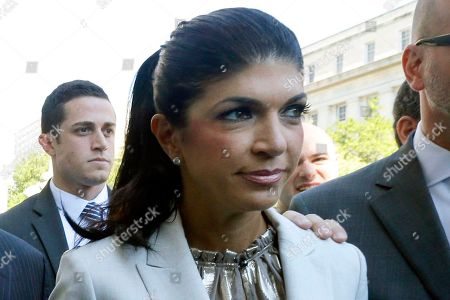 "Teresa Giudice, Giuseppe ""Joe"" Giudice The Real Housewives of New Jersey"" star Teresa Giudice, 41, of Montville Township, N.J., walks out of Martin Luther King, Jr. Courthouse after an appearance in Newark, N.J. Teresa Giudice will be released, from the Danbury Federal Correctional Institution in Connecticut, her lawyer said, and will be on home confinement until Feb. 5, 2016. She served time after pleading guilty in 2014 to bankruptcy fraud"