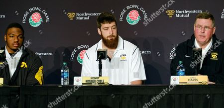 Greg Davis Iowa offensive coordinator Greg Davis, right, is joined by tight end Henry Krieger Coble, center, and running back LeShun Daniels Jr. during a news conference in Los Angeles, . Iowa is scheduled to play Stanford in the Rose Bowl NCAA college football game on New Year's Day