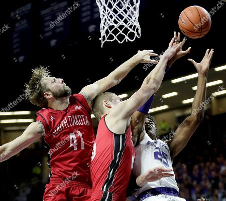 Wesley Iwundu Kansas State's Wesley Iwundu, right, shoots under pressure from South Dakota's Eric Robertson (41) and Tyler Hagedorn during the first half of an NCAA college basketball game, in Manhattan, Kan