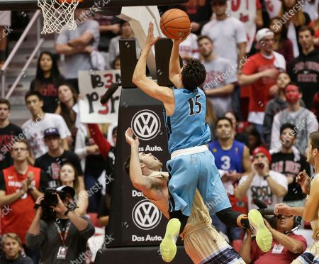 Stock Photo of San Diego State guard Ben Perez collides with San Diego Christian's Josh Richardson in the first half of an NCAA college basketball game, in San Diego