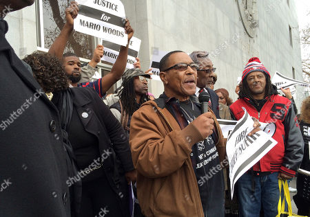 Eli Crawford, center, speaks with demonstrators gathered in front of the Hall of Justice to protest the San Francisco police shooting death of Mario Woods and to demand the dismissal of police chief Greg Suhr in San Francisco, . Woods is the knife-wielding stabbing suspect shot dead in the city's Bayview neighborhood earlier this month
