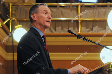 South Dakota Gov. Dennis Daugaard speaks during his budget address at the state Capitol in Pierre, S.D., . Daugaard proposed broadening eligibility for South Dakota's Medicaid program even though he shares some lawmakers' concerns about expanding it