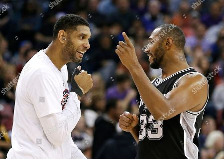 Tim Duncan, Boris Diaw San Antonio Spurs center Tim Duncan, left, greets teammate Boris Diaw as he walks off the floor during timeout in the closing moments of the Spurs 106-88 win over the Sacramento Kings in Sacramento, Calif