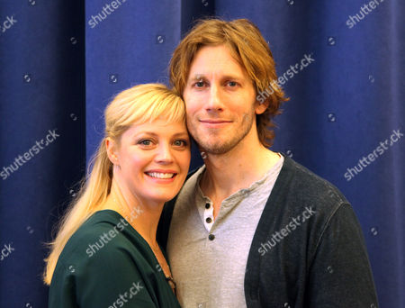 "Elizabeth Stanley and Andrew Samonsky pose for a photo in New York. The couple star in a national tour of ""The Bridges of Madison County,"" a musical based on the Robert James Waller novel, which was made into a 1995 movie starring Meryl Streep and Clint Eastwood. The show is about a four-day love affair in 1965 between a world-weary photographer and an Italian-American housewife"