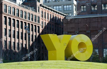 """A bright yellow monumental sculpture by artist Deborah Kass dominates a hill in Brooklyn Bridge Park, in New York. When viewed from Manhattan, the sculpture reads """"Yo,"""" but when viewed from Brooklyn it spells the popular Yiddish expression """"Oy."""" The aluminum sculpture was commissioned by Brooklyn developer Two Trees Management Company and will remain up until August 2016"""