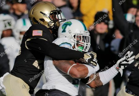 Tulane running back Sherman Badie (3) is tackled by Army cornerback Brandon Jackson (28) during the second half of an NCAA college football game, in West Point, N.Y. Tulane won 34-31