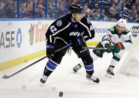 Jarret Stoll, Jonathan Marchessault Tampa Bay Lightning center Jonathan Marchessault (42) carries the puck past Minnesota Wild center Jarret Stoll (19) during the second period of an NHL hockey game, in Tampa, Fla