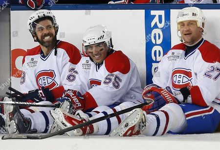 Stock Picture of Eric Desjardins, Francis Bouillon, Alexei Kovalev Former Montreal Canadiens' Eric Desjardins, left, Francis Bouillon, center, and Alexei Kovalev, right, sit on the ice during a shoutout in the Alumni outdoor hockey game at Gillette Stadium against former Boston Bruins players in Foxborough, Mass., where the Bruins will play the Canadiens in the NHL Winter Classic on Friday