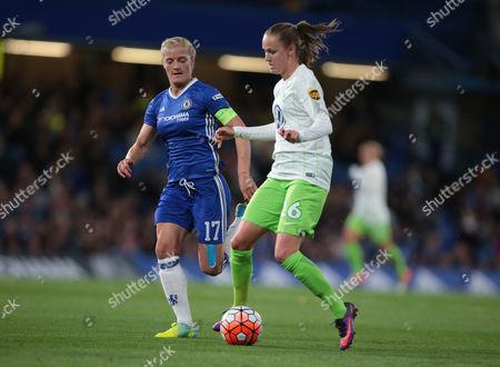 Caroline Graham Hansen of Vfl Wolfsburg tussle with Chelsea Ladies Katie Chapman