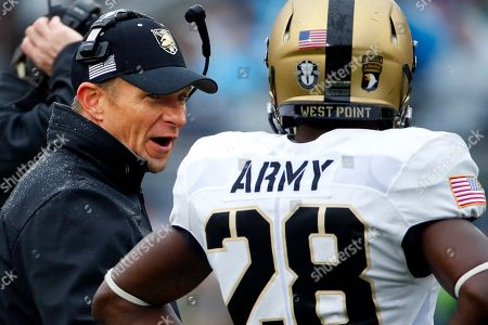 Jeff Monken Army head coach Jeff Monken, left, talks with cornerback Brandon Jackson (28) during a timeout in the first half of an NCAA college football game against Penn State in State College, Pa