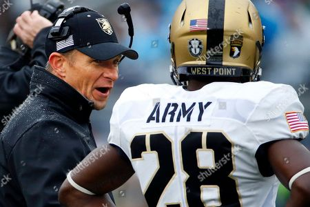 Jeff Monken Army head coach Jeff Monken, left, talks with Army cornerback Brandon Jackson (28) during a timeout in the first half of an NCAA college football game against Penn State in State College, Pa