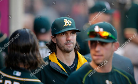 Barry Zito Oakland Athletics starting pitcher Barry Zito, center, walks through the dugout during the fifth inning of a baseball game against the Los Angeles Angels, in Anaheim, Calif