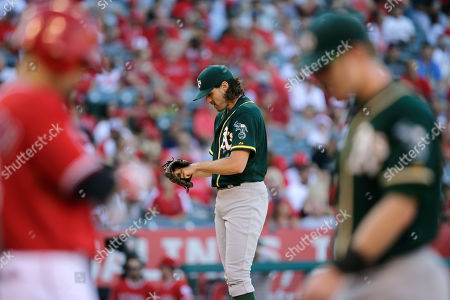 Barry Zito Oakland Athletics starting pitcher Barry Zito, center, stands on the mound after walking Los Angeles Angels' Shane Victorino, foreground left, during the second inning of a baseball game, in Anaheim, Calif