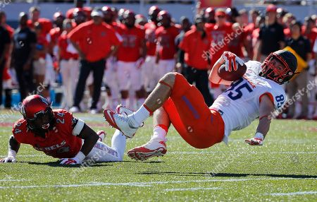 Boise State tight end Holden Huff (85) falls after gaining yards against UNLV defensive back Fred Wilson (24) during the first half of an NCAA college football game, in Las Vegas