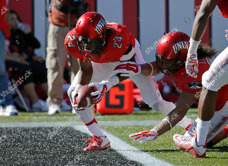 UNLV defensive back Fred Wilson (24) scores a touchdown after recovering a fumble by Boise State during the first half of an NCAA college football game, in Las Vegas