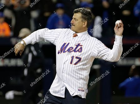 "Keith Hernandez Keith Hernandez throws out the ceremonial first pitch before Game 1 of the National League baseball championship series between the New York Mets and the Chicago Cubs, in New York. Hernandez, the outspoken broadcaster, ""Seinfeld"" favorite and former All-Star first baseman is working on a ""no-holds-barred"" memoir. Little, Brown and Company told The Associated Press on Monday, Dec. 7, 2015, that ""I Am Keith Hernandez"" is scheduled for 2017"