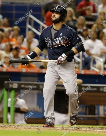 Nick Swisher Atlanta Braves' Nick Swisher bats during a baseball game against the Miami Marlins, in Miami. The Dolphins defeated the Braves 12-11