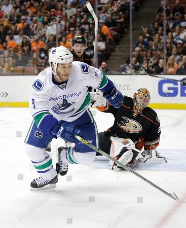 Brandon Prust, Frederik Andersen Vancouver Canucks' Brandon Prust, left, goes after the puck as Anaheim Ducks goalie Frederik Andersen, of Denmark, watches during the first period of an NHL hockey game, in Anaheim, Calif