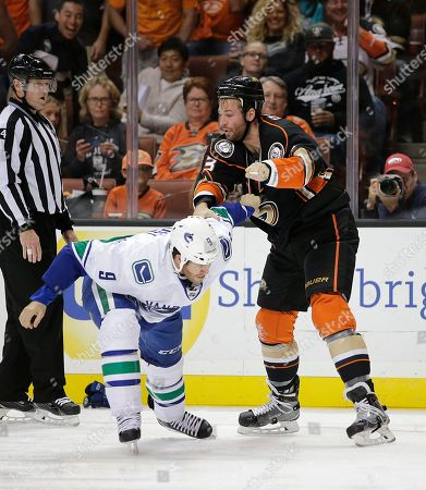 Clayton Stoner, Brandon Prust Anaheim Ducks' Clayton Stoner, right, fights with Vancouver Canucks' Brandon Prust during the first period of an NHL hockey game, in Anaheim, Calif