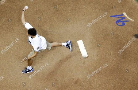 Milwaukee Bucks Michael Carter-Williams throws a ceremonial first pitch a baseball game between the Milwaukee Brewers and the St. Louis Cardinals, in Milwaukee