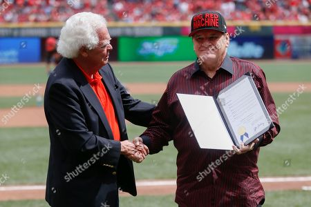"Pete Rose, David Mann Former Cincinnati Reds' great Pete Rose, right, shakes hands with Cincinnati Vice Mayor David Mann on the field at Great American Ball Park before a baseball game between the Cincinnati Reds and the St. Louis Cardinals, in Cincinnati. During a brief ceremony, the City of Cincinnati declared Sept. 12, 2015 ""Pete Rose Day"