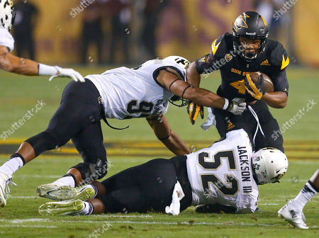 Demario Richard, Leo Jackson III Arizona State running back Demario Richard (4) is hit by Colorado defensive lineman Leo Jackson III (52) during the first half of an NCAA college football game, in Tempe, Ariz. Richared fumbled the ball on the play and Arizona State recovered for a touchdown