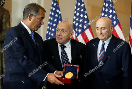 John Boehner, Harry Ettlinger, Richard Barancik House Speaker John Boehner of Ohio, left, presents the Congressional Gold Medal to Monuments Men Harry Ettlinger, center, and Richard Barancik, during a ceremony in Emancipation Hall on Capitol Hill in Washington. The award is Congress' highest honor of appreciation for distinguished achievement