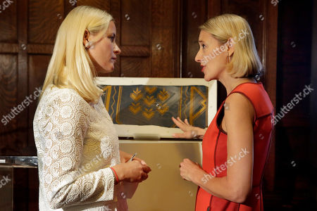 Stock Photo of Crown Princess Mette-Marit, Caroline Baumann Crown Princess Mette-Marit of Norway, left, and Cooper Hewitt Director Caroline Baumann, stand beside the gift of a Norwegian textile to Cooper Hewitt's wallcoverings collection, during ceremonies at the Cooper Hewitt, Smithsonian Design Museum,in New York. The original wallpaper is from the United Nations Security Chamber, donated to the UN in 1952