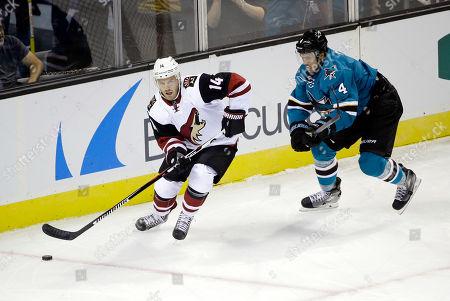 Joe Vitale, Brenden Dillon Arizona Coyotes' Joe Vitale (14) in action against San Jose Sharks' Brenden Dillon (4) during the first period of an NHL preseason hockey game, in San Jose, Calif