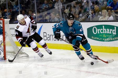 Mirco Mueller, Joe Vitale San Jose Sharks' Mirco Mueller (41) is chased by Arizona Coyotes' Joe Vitale (14) during the second period of an NHL preseason hockey game, in San Jose, Calif