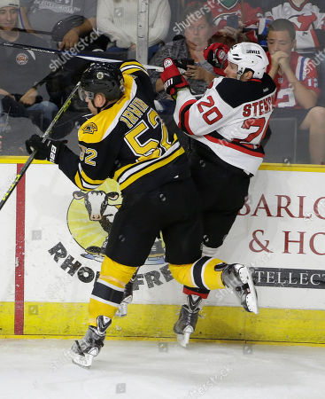 Stock Picture of Matt Irwin, Lee Stempniak Boston Bruins defenseman Matt Irwin, left, and New Jersey Devils right wing Lee Stempniak, right, collide during the first period of an NHL preseason hockey game, in Providence, R.I. The Bruins won 2-0