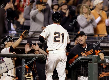 Nick Noonan, Bruce Bochy San Francisco Giants' Nick Noonan (21) is congratulated by manager Bruce Bochy, right, after hitting a home run off Los Angeles Dodgers' Joel Peralta in the seventh inning of a baseball game, in San Francisco