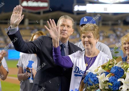 Nancy Bea Hefley, Orel Hershiser Former Los Angeles Dodgers pitcher Orel Hershiser waves with organist Nancy Bea Hefley during a ceremony prior to a baseball game between the Dodgers and the San Diego Padres, in Los Angeles. Hefley, whose organ has provided the musical backdrop to the action on the field for the Los Angeles Dodgers for 28 years, is retiring at season's end