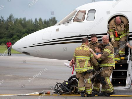 Stock Photo of Marissa Meyer Miami-Dade Fire Rescue personnel carry out volunteer Marissa Meyer, 13, foreground center, from an airplane during a live fire drill at the Miami-Opa locka Executive Airport, in Opa-Locka, Fla. Members from the Miami-Dade Police Dept., Miami-Dade Aviation Dept. and Fire Rescue participated in the drill designed to test responders during a controlled emergency at the airport