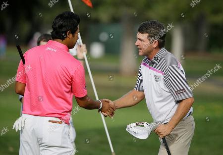 Jason Bohn, Hideki Matsuyama Jason Bohn, right, is greeted by Hideki Matsuyama, left, of Japan, after finishing play on the 18th green of the Silverado Resort North Course during the third round of the Frys.com PGA Tour golf tournament, in Napa, Calif