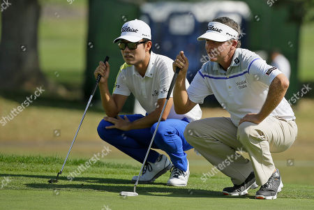 Jason Bohn, Kevin Na Kevin Na, left, and Jason Bohn, right, line up their putts on the second green of the Silverado Resort North Course during the final round of the Frys.com golf tournament, in Napa, Calif