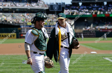 Barry Zito, Stephen Vogt Oakland Athletics pitcher Barry Zito, right, and Stephen Vogt prepare to face the San Francisco Giants prior to a baseball game, in Oakland, Calif