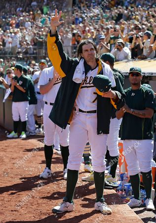 Barry Zito Oakland Athletics pitcher Barry Zito waves to fans as he leaves the baseball game against the San Francisco Giants in the third inning of a baseball game, in Oakland, Calif
