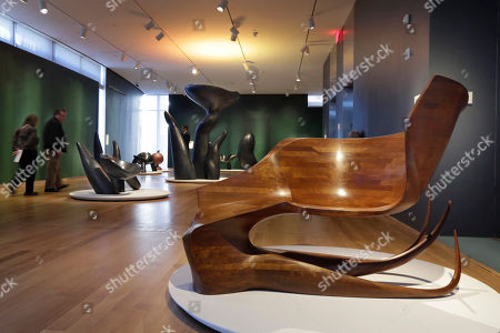 """Squid Chair No. 1 Squid Chair No. 1,"""" right, part of the Wendell Castle Remastered exhibit, is displayed at the Museum of Arts and Design, in New York. The museum show explores the recent work of Wendell Castle, 83, sometimes called the father (or grandfather) of the American art furniture movement for pieces that are both sculpture and furniture"""
