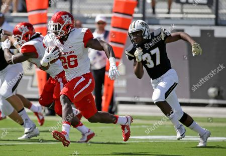 Houston running back Tyreik Gray returns a kickoff as he gets past Central Florida's Michael Willett (37) during the first half of an NCAA college football game, in Orlando, Fla