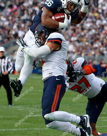 Saquon Barkley, Taylor Barton Penn State running back Saquon Barkley (26) is hit by Illinois defensive back Taylor Barton (3) as he crosses the goal line for a touchdown during the second half of an NCAA college football game in State College, Pa., . Penn State won 39-0
