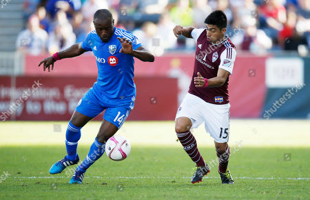 Nigel Reo-Coker Montreal Impact midfielder/defender Nigel Reo-Coker (14), left, battles for control of the ball with Colorado Rapids in the first half of a MLS soccer match in Commerce City, Colo