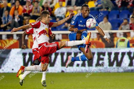Didier Drogba, Damien Perrinelle Montreal Impact forward Didier Drogba, right, and New York Red Bulls defender Damien Perrinelle compete for the ball during the first half of an MLS soccer match, in Harrison, N.J