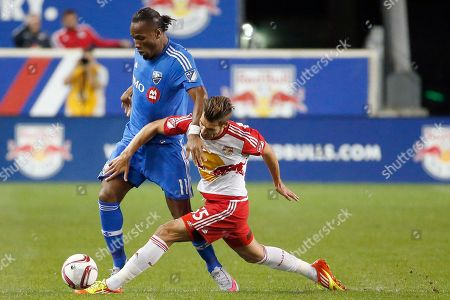 Didier Drogba, Damien Perrinelle Montreal Impact forward Didier Drogba, left, competes for the ball against New York Red Bulls defender Damien Perrinelle during the first half of an MLS soccer match, in Harrison, N.J