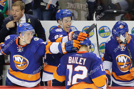 Josh Bailey New York Islanders left wing Josh Bailey (12) is congratulated by teammates Ryan Strome, left, Anders Lee (27) and Mikhail Grabovski (84), of Germany, after scoring an empty-net goal in the third period of an NHL hockey game against the Winnipeg Jets, in New York. The Islanders won 4-2. Doug Weight, top left, senior advisor to the general manager and assistant coach of the Islanders, gestures