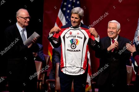 John Kerry, Richard Lugar, Lee Hamilton Secretary of State John Kerry displays a bicycle jersey presented to him between former Indiana Rep. Lee Hamilton, left, and former Indiana Sen. Richard Lugar, right, after speaking about U.S. foreign policy priorities, at Indiana University in Bloomington, Ind. Kerry spoke to mark the opening of the new building for IU's School of Global and International Studies