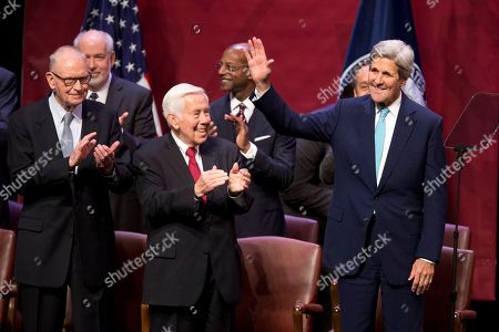 John Kerry, Lee Hamilton, Richard Lugar Secretary of State John Kerry waves as he takes the stage in front of former Indiana Rep. Lee Hamilton, left, and former Indiana Sen. Richard Lugar, prior to speaking about U.S. foreign policy priorities, at Indiana University in Bloomington, Ind. Kerry spoke to mark the opening of the new building for IU's School of Global and International Studies