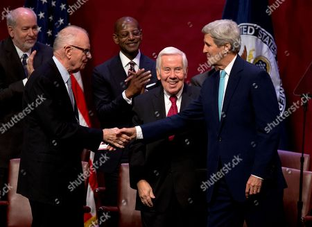 John Kerry, Richard Lugar, Lee Hamilton Secretary of State John Kerry greets former Indiana Rep. Lee Hamilton, left, and former Indiana Sen. Richard Lugar, center, after speaking about U.S. foreign policy priorities,Thursday, Oct. 15,2015, at Indiana University in Bloomington, Ind. Kerry spoke to mark the opening of the new building for IU's School of Global and International Studies