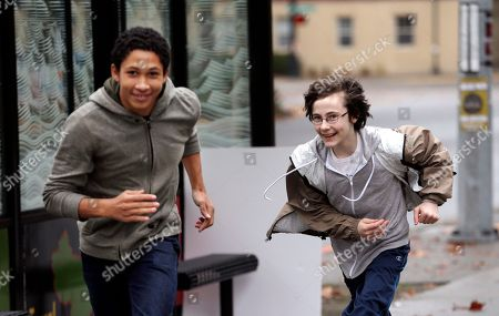 Young environmental activists Aji Piper, 15, left, and Gabriel Mandell, 13, race around in a game of tag after a rally they both spoke at in Seattle. The two are among eight youth activists who petitioned Washington state last year to adopt stricter science-based regulations to protect them against climate change