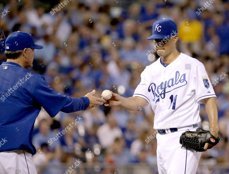 Jeremy Guthrie Kansas City Royals starting pitcher Jeremy Guthrie hands the ball to manager Ned Yost as he comes out during the third inning of a baseball game after giving up nine runs to the Seattle Mariners, in Kansas City, Mo